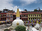 A smaller buddhist stupa next to the giant Boudhanath stupa, part of Nepal's four UNESCO World Heritage Sites. The stupa is one of the most holy sites of pilgrimage for Buddhists around the world. Near Kahmandu, in the valley.