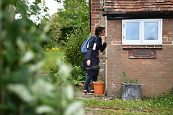 © Licensed to London News Pictures. 27/05/2019. Thame, UK. A BBC journalist speaks to Conservative Party leadership candidate BORIS JOHNSON MP through the door of his Oxfordshire home. British Prime Minister Theresa May announced on Friday that she will stand down in June. Photo credit: Ben Cawthra/LNP