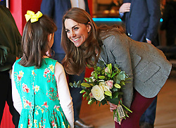 The Duchess of Cambridge is presented with flowers from Michaela Conway, aged eight from Eltham, during a volunteer celebration event with the charity Shout at the Troubadour White City Theatre in London.