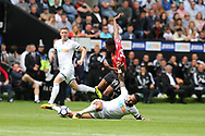 Marcus Rashford of Manchester Utd is tackled by Kyle Bartley of Swansea city (on ground).  Premier league match, Swansea city v Manchester Utd at the Liberty Stadium in Swansea, South Wales on Saturday 19th August 2017.<br /> pic by  Andrew Orchard, Andrew Orchard sports photography.