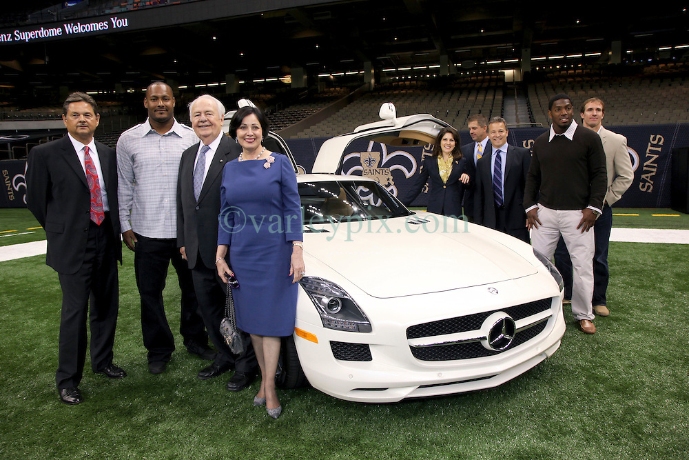 04 October 2011. New Orleans, Louisiana, USA.  <br /> NFL's New Orleans Saints announce a multi million dollar deal with Mercedes-Benz for naming rights on the Louisiana Superdome. Now the Mercedes-Benz Superdome. Group inclucing Quarterback Drew Brees, Gayle Benson (wife of Tom), Saints owner Tom Benson, grand daughter, part owner and Saints VP Rita Benson Leblanc, Mercedes-Benz VP Marketing Stephen Cannon, Mercedes-Benz USA President and CEO Ernst Leib, player Jon Vilma and coach Sean Payton.<br /> Photos; Charlie Varley/varleypix.com