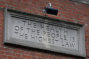 "The day after UK Prime Minister Boris Johnson addressed the nation with his roadmap for the coming weeks and months during the Coronavirus pandemic lockdown, is the inscription 'The Health of the People is the Highest Law' - a quote translated from the Latin, of Roman philosopher Cicero's 'De Legibus' speech: ""Salus populi suprema lex esto."" The quote is above the main doorway of Walworth Clinic on Walworth Road in south London, a 1937 Grade II listed Art Deco building whose concept predated the establishment of the National Health Service, on 11th May 2020, in London, England."