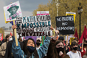 Thousands of people march along the Mall holding signs during a Kill The Bill demonstration as part of a National Day of Action to mark International Workers Day on 1st May 2021 in London, United Kingdom. Nationwide protests have been organised against the Police, Crime, Sentencing and Courts Bill 2021, which would grant the police a range of new discretionary powers to shut down protests.