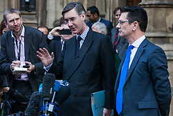 London, UK. 15th November, 2018. Jacob Rees-Mogg, Conservative MP for North-East Somerset, appears outside the House of Commons with Steve Baker, Conservative MP for Wycombe, to announce the sending of a letter of no confidence in Prime Minister Theresa May following the Cabinet resignations of Brexit Secretary Dominic Raab and Work and Pensions Secretary Esther McVey and the day after the Prime Minister gained Cabinet approval of a draft Brexit agreement .