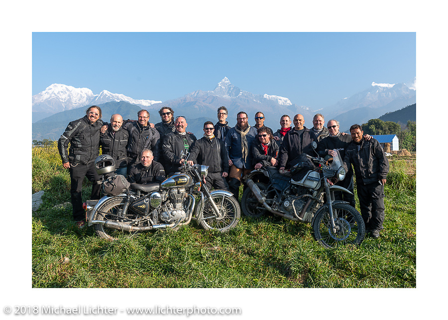 Our group posing with a spectacular background of 23,000' peaks on day-4 our our Himalayan Heroes adventure riding from Pokhara to Kalopani, Nepal. Friday, November 9, 2018. Photography ©2018 Michael Lichter.