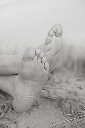 detail of a man's feet on the beach