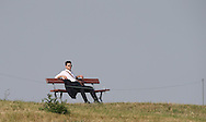 Rest your weiry legs my son ! Spectator on the bench overlooking the 9th  during Round One of the 2015 Alstom Open de France, played at Le Golf National, Saint-Quentin-En-Yvelines, Paris, France. /02/07/2015/. Picture: Golffile | David Lloyd<br /> <br /> All photos usage must carry mandatory copyright credit (© Golffile | David Lloyd)