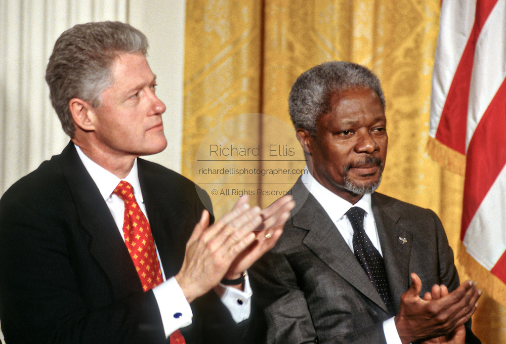 US President Bill Clinton with UN Secretary General Kofi Annan during an event in the East Room at the White House March 11, 1998 in Washington, DC.