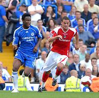 Photo: Ed Godden.<br />Chelsea v Charlton Athletic. The Barclays Premiership. 09/09/2006. Jon Obi Mikel (L) is followed by Charlton's Luke Young.
