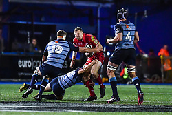 Scarlets' Hadleigh Parkes is tackled by Cardiff Blues' Jarrod Evans - Mandatory by-line: Craig Thomas/Replay images - 31/12/2017 - RUGBY - Cardiff Arms Park - Cardiff , Wales - Blues v Scarlets - Guinness Pro 14