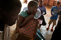 Phiona Mutesi, a 14-year-old chess prodigy, at the Agape Church inside Katwe, the largest slum in Kampala, Uganda, Dec. 10, 2010. Mutesi lives in the slums of Uganda and is just now learning to read. But her instincts have made her a player to watch in international chess. Mutesi, a naturally talented chess player is coached by Robert Katende of Sports Outreach Ministry. The chess club meets at the Agape Church inside Katwe.