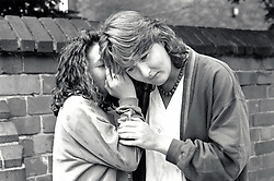 Teenage girl whispering Nottingham UK 1990