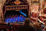 Opera-lovers await the start of a rehearsal of the first socially-distanced performance by English National Opera (ENO) in the London Coliseum which has remained closed throughout the Coronavirus pandemic lockdown, on 24th October 2020, in London, England. Musicians and singers on stage are separated appropriate to government restrictions and audience members are seated with same household groups. The Marriage of Figaro was ENO's last show on 14th March, and the Coliseum has stayed closed until now. The UK's theatre ticket revenue contributes £1.28bn to the nation's economy, in which there are 290,000 jobs (70% are at risk) so the government has announced a financial rescue package for the Arts industry, a £1.15bn support for cultural organisations in England that is made up of £880m in grants and £270m of repayable loans. The 2,395-seat Coliseum (1904) is a Baroque revival (Wrenaissance) style theatre, built as one of West End's largest and most luxurious variety theatres.00