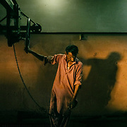 A worker moves an ice lifting tool inside an old British ear ice factory.