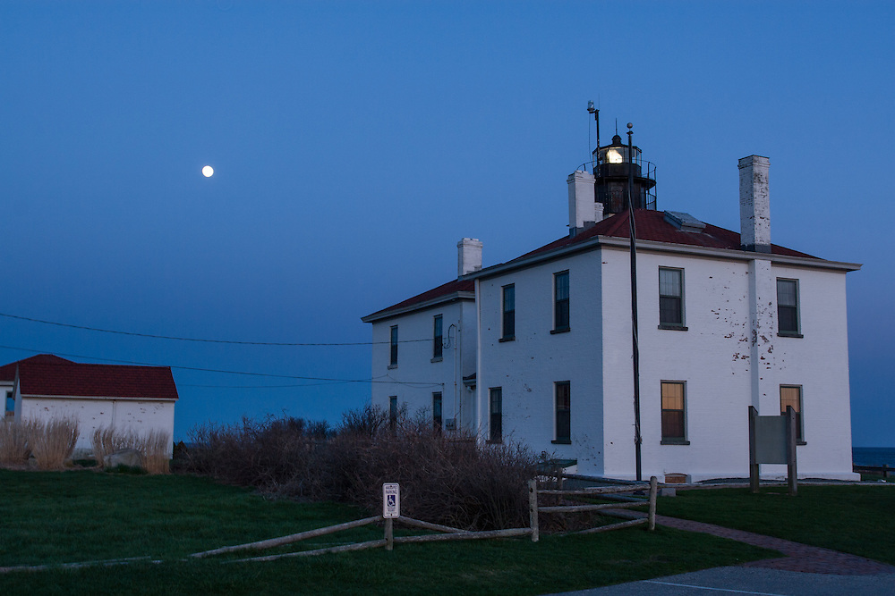 Beavertail Lighthouse and the light keeper's cottage in Jamestown, Rhode Island, at sunset. The first  lighthouse was built on this spot in 1749; the present lighthouse dates to 1856.
