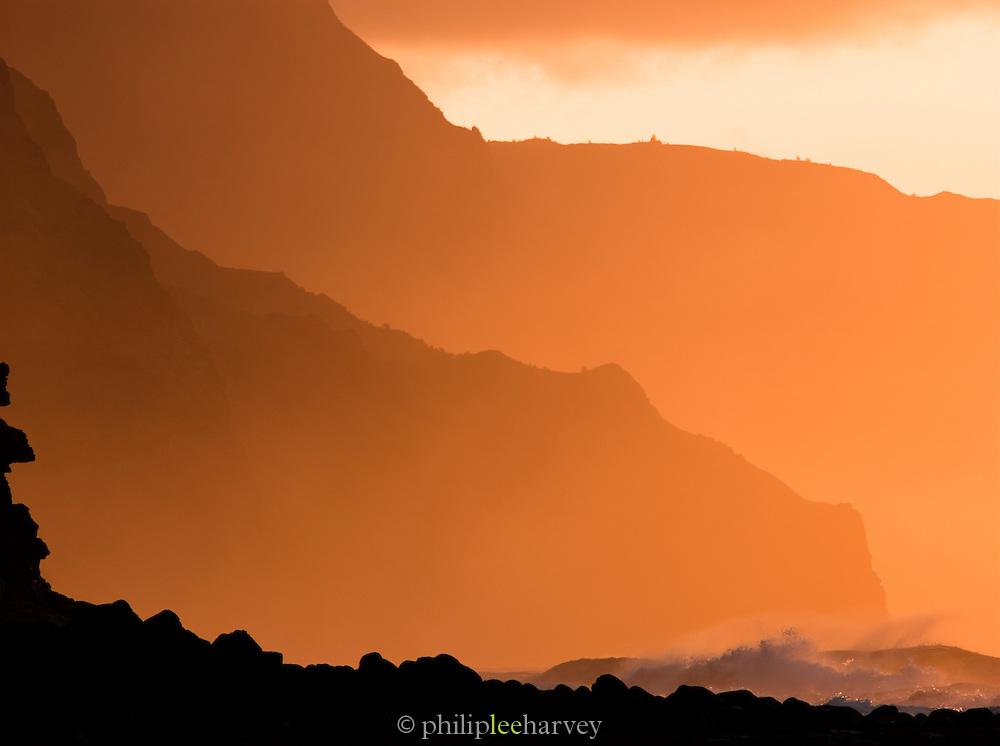 Waves crash on Ke'e Beach, Ha'ena State Park at dusk, Kaua'i, Hawai'i