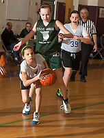 Gilford's looks to pass the ball in the senior girls championship game with Team TTCC on Sunday morning during the 20th annual Francoeur Babcock Basketball Tournament at Gilford Middle School.  (Karen Bobotas/for the Laconia Daily Sun)