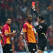 Referee's Ozgur Yankaya show the Red card to Galatasaray's Gokhan Zan (L) during their Turkish Super League soccer match Galatasaray between Genclerbirligi at the TT Arena at Seyrantepe in Istanbul Turkey on Friday, 08 March 2013. Photo by Aykut AKICI/TURKPIX