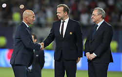Real Madrid manager Zinedine Zidane shakes hands with Manchester United vice-chairman Ed Woodward and Read Madrid president Florentino Perez (right) after the UEFA Super Cup match at the Philip II Arena, Skopje, Macedonia.