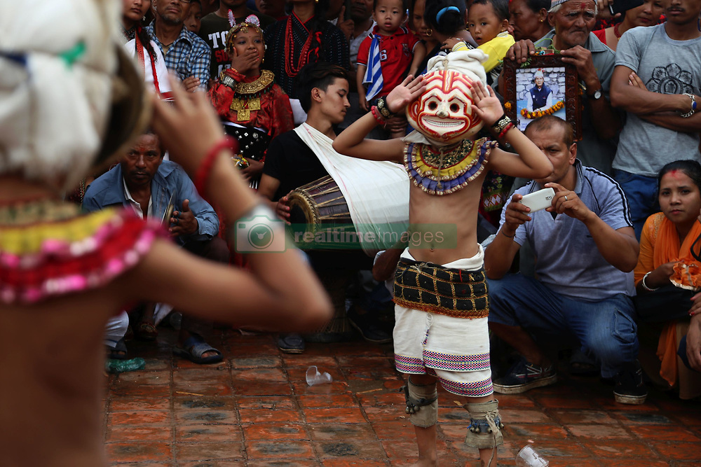 August 8, 2017 - Bhaktapur, Nepal - Masked dancers perform in celebration of Gaijatra festival or the festival of cows in Bhaktapur. Hindus celebrated the festival in commemorate of the death loved ones and pray for peace soul honouring cows or decorate people as cow in the streets. (Credit Image: © Archana Shrestha/Pacific Press via ZUMA Wire)