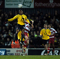 Photo: Jed Wee.<br /> Doncaster Rovers v Arsenal. Carling Cup. 21/12/2005.<br /> <br /> Arsenal's Gilberto Silva (L) beats Doncaster's Sean Thornton to the ball.