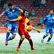Galatasaray's Engin Baytar (C) and MP Antalyaspor's Ibrahim Dagasan (L) during their Turkish Super League soccer match Galatasaray between MP Antalyaspor at the TT Arena Stadium at Seyrantepe in Istanbul Turkey on Saturday 01 February 2012. Photo by TURKPIX