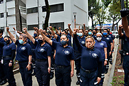 Paramedics lift their hands during a mass to remember victims who lost their lives in the earthquake of 2017 at Tlalpan Multifamily amid coronavirus pandemic. (Photo by Carlos Tischler/Speed Media)
