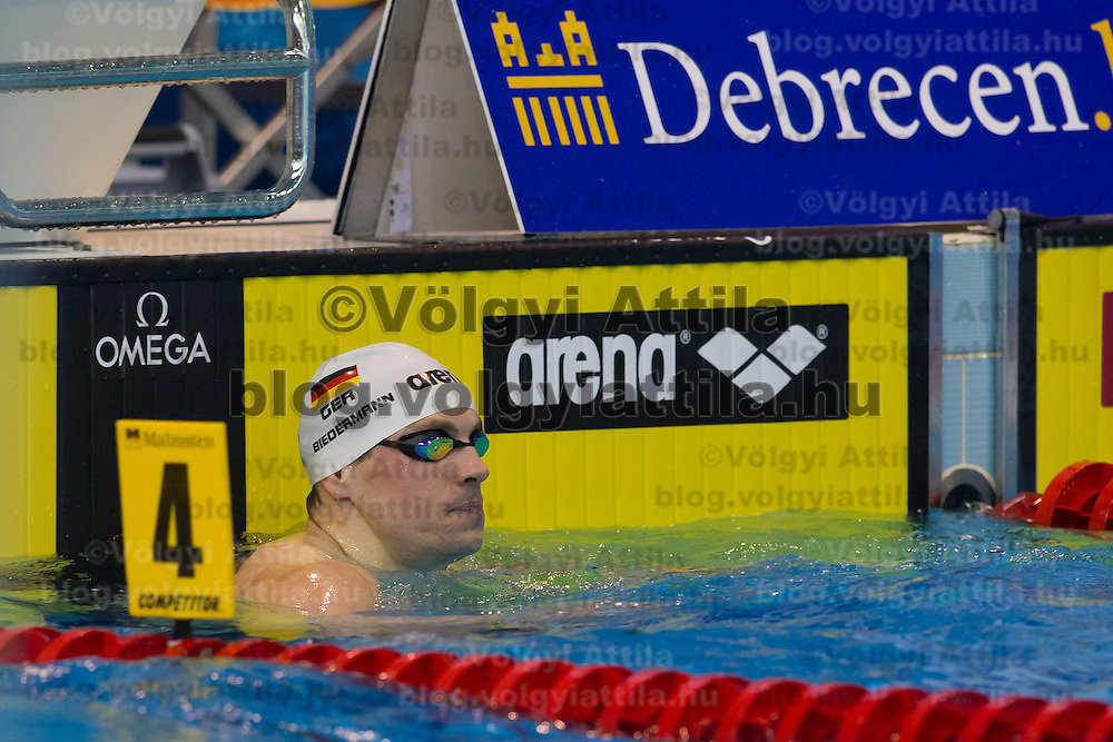 Paul Biedermann of Germany celebrates his victory in the men's 400m freestyle final of the 31th European Swimming Championships in Debrecen, Hungary on May 21, 2012. ATTILA VOLGYI