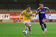 Brighton and Hove Albion striker Danny Cashman (51) battles with AFC Wimbledon midfielder Anthony Hartigan (8) during the EFL Trophy Southern Group G match between AFC Wimbledon and Brighton and Hove Albion U21 at The People's Pension Stadium, Crawley, England on 22 September 2020.