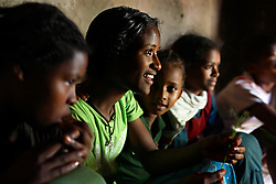 Tsegaya Mekonen, 13, sits with her friends while waiting for her groom Talema Meseret, 20, on their wedding day in Yeganda Village, Amhara Region, Ethiopia on May 23, 2007. The practice of early marriage remains widespread in Ethiopia, especially in the northern Amhara and Tigray regions, where parents consent to their daughters' consummated marriages when they are still as young as 10 or 12. In Amhara, 50 percent of girls are married by the age of 15, despite the enactment in 2000 of the revised Family Law, which sets the legal age for marriage at 18.