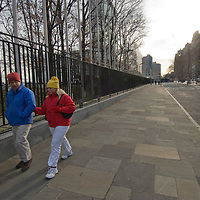A couple walks along First Avenue near the United Nations Building in New York City.
