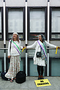 Maria and Michelle from Lancashire tied onto the railings at Dep For Energy, Business and Industrial Strategy in a symbolic protest against fracking. Up to a hundred women from the Lancashire anti-fracking movement dressed as suffragettes congregate in Parliament Square and pay the Dep For Energy, Business and Industrial Strategy a visit, London, Unted Kingdom, September 12 2018