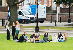 "© Licensed to London News Pictures; 22/09/2020; Bristol, UK. A group of 10 young people sit on College Green with 3 others standing nearby. Groups of people, some more than six in number, can still be seen in Bristol city centre, after the Prime Minister today announced new restrictions which could last for up to six months and also warned of significantly greater restrictions if necessary, amid concerns about a second wave of the covid-19 coronavirus pandemic across the UK. Penalties for gathering in groups of more than six will increase from £100 to £200 on the first offence. From Monday 14 September it was illegal to meet up socially in groups of more than six people, known as the ""Rule of Six"", in order to try and contain the spread of the covid-19 coronavirus pandemic, and police have said they will enforce the law with fixed penalty notices which will increase for repeat offenders. Photo credit: Simon Chapman/LNP."