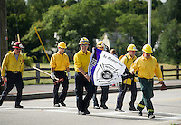 Members of Laconia Fire Department march in memoriam to the fallen Arizona Firefighters during Saturday's annual WOW Fest event in Laconia.  (Karen Bobotas/for the Laconia Daily Sun)