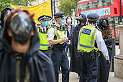 Police search climate and animal justice group, Animal Rebellion protestors who presented an open letter to the UK Government on Tuesday, Sept 8, 2020. The letter, signed by a coalition of doctors, zoologists, NGOs, as well as climate and animal justice organisations, suggests that animal agriculture is a key driver in the emergence of deadly diseases and pandemics.<br /> Activists dressed in black-clad marched and held a funeral procession as part of the letter delivery outside Downing Street. (VXP Photo/ Vudi Xhymshiti)