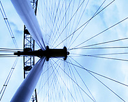 The London Eye, this amazing image shows the London eye up close and personal. Here we see how this massive structure actually resembles its smaller cousin the bicycle wheel. We can see the industrial sized spokes that help this tourist attraction and monument rotate in the centre of London, England.