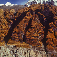 A mountain rises above the Annapurna Sanctuary, Nepal.