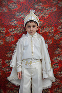 Can Umut after his traditional circumcision in Sariyer, a town on the Bosphorus coastline north of Istanbul. The boys dress in costumes of Ottoman sultans on the day when they are seen as stepping into manhood.