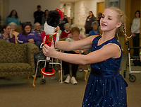 "Josephina Scoog as ""Clara"" dances with her nutcracker for the Taylor Community as the Lakes Region Dance Company performs The Nutcracker on Monday evening.  (Karen Bobotas/for the Laconia Daily Sun)"