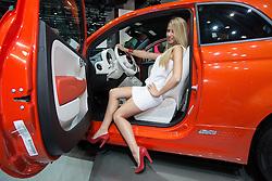 10.09.2013, Messegelaende, Frankfurt, GER, IAA 2013, im Bild Modell sitzt im Fiat 500 elektro // during the IAA 2013 at the Messegelaende in Frankfurt, Germany on 2013/09/10. EXPA Pictures © 2013, PhotoCredit: EXPA/ Eibner/ Alexander Neis<br /> <br /> ***** ATTENTION - OUT OF GER *****
