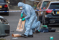 © Licensed to London News Pictures. 20/07/2020. London, UK. A forensic investigator places a shoe in an evidence bag at the crime scene as police launch investigation after two people were stabbed in Tower Hamlets. Photo credit: Peter Manning/LNP
