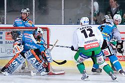 Petr SACHL (HDD Tilia Olimpija, #12) vs Alex Westlund (EHC Liwest Black Wings Linz, #32) during ice-hockey match between HDD Tilia Olimpija and EHC Liwest Black Wings Linz in 19th Round of EBEL league, on November 7, 2010 at Hala Tivoli, Ljubljana, Slovenia. (Photo By Matic Klansek Velej / Sportida.com)
