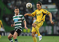 20120329: LISBON, PORTUGAL - Football - UEFA Europe League 2011/2012 - Quarter-finals, First leg: Sporting CP vs Metalist<br />In picture: Sporting's Marat Izmailov, from Russia, left, fights for the ball with Metalist's Milan Obradovic, from Serbia.<br />PHOTO: Alvaro Isidoro/CITYFILES
