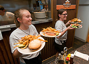 Maxine Hansford and mother Dawn Bollinger bring out an order of MacPhail's Burgers on Tuesday after Trip Advisor recently ranked the restaurant the 10th best burger in America and the third best place to eat in Jackson.