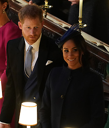 The Duke and Duchess of Sussex at the wedding of Princess Eugenie to Jack Brooksbank at St George's Chapel in Windsor Castle.