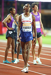 © Licensed to London News Pictures. 24/07/2015. London, UK. British long-distance and middle-distance runner Mo Farah prepares for the 3000m in the Diamond League meet at the Olympic Stadium as part of the Sainsbury's Anniversary Games. Photo credit: LNP