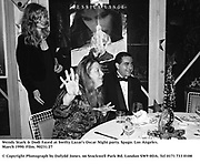 Wendy Stark & Dodi Fayed at Swifty Lazar's Oscar Night party. Spago. Los Angeles. March 1990.<br /><br />© Copyright Photograph by Dafydd Jones<br />66 Stockwell Park Rd. London SW9 0DA<br />Tel 0171 733 0108<br />Film. 90231/27