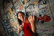 """5/4/06 -- Aurora, IL, U.S.A<br /> Cindy Wang , one of USA TODAY's 2006 All-USA High School Academic Team members, holds her violin in front of a mural at the Illinois Mathematics and Science Academy. The mural entitled """"Building An Integrated Community in Aurora"""" was made by students from IMSA and other schools entirely from bits of pages torn from old National Geographic magazines. Wang was NOT part of the group that made the mural.<br /> <br /> Photo by John Zich, USA TODAY contract photographer"""