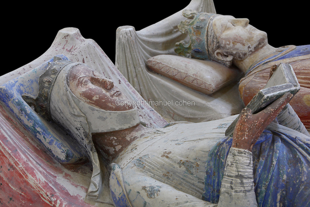 Royal tombs of Eleanor of Aquitaine and King Henry II of England in the nave of the Abbey Church at Fontevraud Abbey, Anjou, France. Eleanor of Aquitaine, 1122-1204, is seen here with her husband King Henry II of England and is reading a book, a symbol of her unusual stature and learning. The Plantagenet rulers were benefactors of the monastery. The effigy is carved in stone and was painted, she wears a crown and nun's wimple and her robes are blue and white. Fontevraud Abbey was founded in 1100 by Robert of Arbrissel and became a double monastery for both monks and nuns, led by an Abbess. The abbey is listed as a historic monument and a UNESCO World Heritage Site. Picture by Manuel Cohen