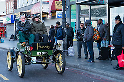 EDITORIAL USE ONLY Jodie Kidd and James Healy, Harrods' Director of Store Operations, drive the Harrods 1901 veteran Pope Waverley electric car through Brixton in south London during the Bonhams London to Brighton Veteran Car Run.